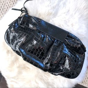 Bryna Nicole black patent leather clutch bag